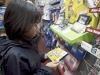 In this photo provided by Nintendo of America, Joanna Reyes, 10, of Seattle searches the shelves at the GameStop Southcenter store in Seattle in pursuit of New Super Mario Bros. 2, a must-have Nintendo 3DS game, during a Black Friday shopping trip on Nov. 23, 2012.